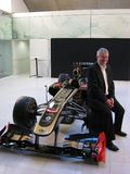 PM sitting on Lotus tyre